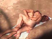 Lovemaking on a public nudist beach filmed by spycam