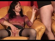 Mature lady gives a gentle hand job to a horny stud