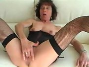 Slutty mature mistress sucks a hard knob and masturbates