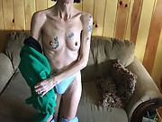 Skinny tatted granny stripping and displaying her hairy cooter