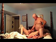Mature married couple experimenting with sex fucktoys on four poster bed