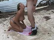 Giant titted wife having doggy sex on the beach
